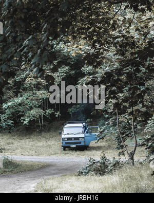 Blue hipster van parked for camping at Mt Franklin near Daylesford. - Stock Photo