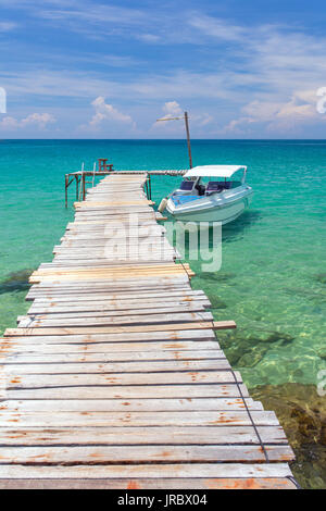 Yacht at the jetty on Koh Kood island in Thailand - Stock Photo