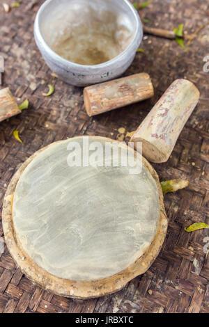Thanaka wood and Kyauk pyin stone slab. Tanaka is Burmese tradition cosmetic made from bark of tanaka tree. - Stock Photo