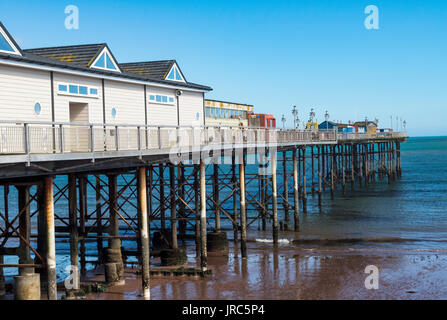 Side View Looking Towards the End of Teignmouth Grand Pier: Teignmouth, Devon, England. - Stock Photo