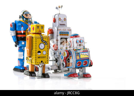 Group of Retro Tin Robots on a white background with copy space - Stock Photo