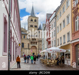 Cafe in front of Trier Cathedral (High Cathedral of Saint Peter), reportedly the oldest cathedral in the country, - Stock Photo