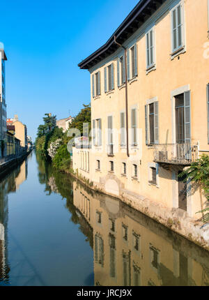 Milan (Lombardy, Italy): the canal of Martesana with historic buildings reflected in the water - Stock Photo