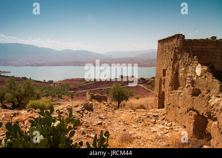 ruin of a kasbah with view of lake against sky in a sunny day - bine el ouidane - morocco - Stock Photo