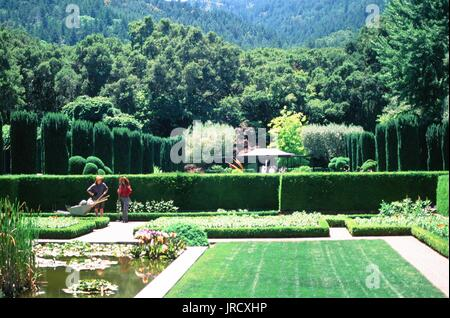 Two gardeners tend to the sunken gardens at Filoli Gardens, a Stock ...