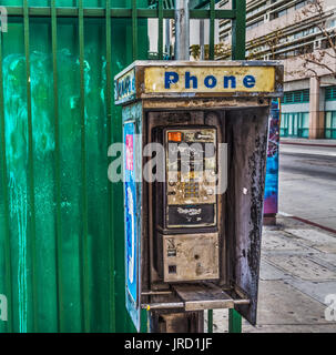 Broken public phone in downtown Los Angeles, California - Stock Photo