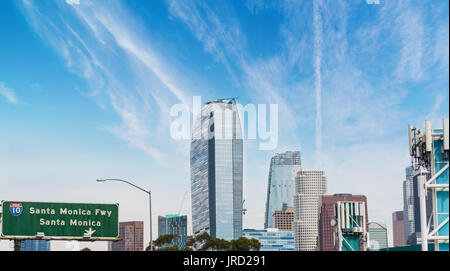 Santa Monica freeway sign with downtown Los Angeles on the background, California - Stock Photo