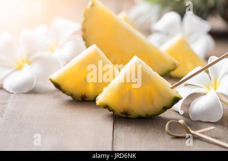 sliced pineapple on wood background, popular fruit in summer season - Stock Photo