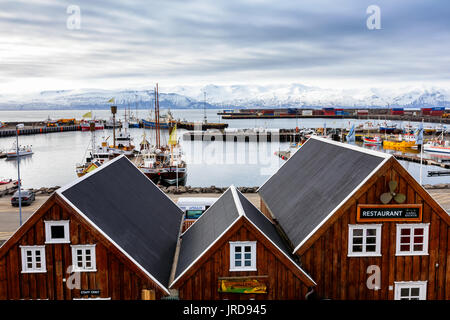 Husavik, Iceland - March 29, 2017: Beautiful view of the historic town of Husavik with traditional houses and traditional - Stock Photo