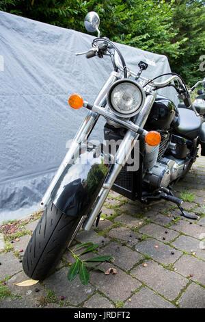 Black and Chrome Honda Motorbike Parked on Drive Way - Stock Photo