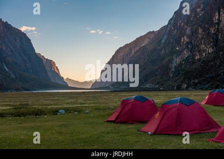 Multiple camping tents set up near Lake Llanganuco Orconcocha of the Cordillera Blanca in Huascaran National Park, - Stock Photo