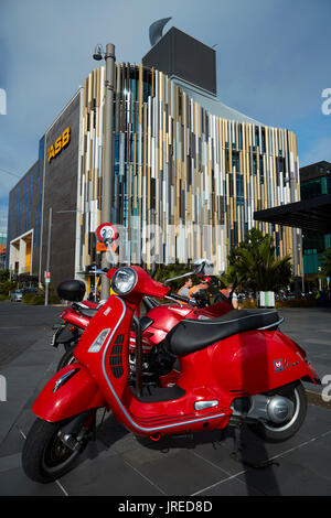ASB Building and red Vespa scooter, Wynyard Quarter, Auckland waterfront, North Island, New Zealand - Stock Photo