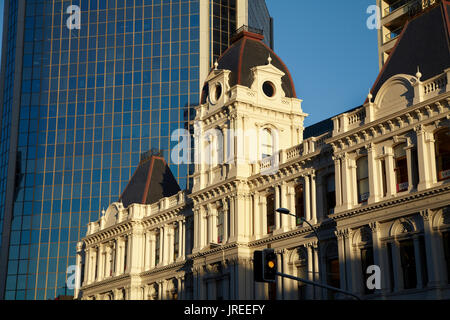 Historic Customhouse and modern glass building, Auckland, North Island, New Zealand - Stock Photo