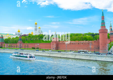 MOSCOW, RUSSIA - MAY 11, 2015: The huge size of Moscow Kremlin is best seen from other side of Moskva river, on - Stock Photo