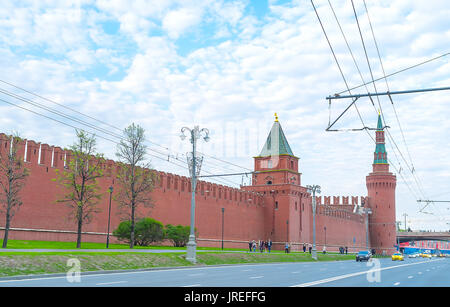 MOSCOW, RUSSIA - MAY 11, 2015: Beautiful red Kremlin walls with Beklemishevskaya and Petrovskaya towers, on May - Stock Photo