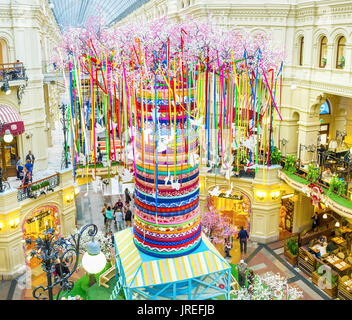 MOSCOW, RUSSIA - MAY 11, 2015: Installation in form of giant colorful tree with blooming branches in gallery of - Stock Photo