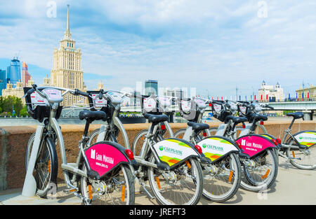 MOSCOW, RUSSIA - MAY 11, 2015: The municipal bicycles for rent located on Smolenskaya embankment, on May 11 in Moscow - Stock Photo