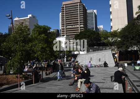 Brisbane, Australia: Office workers enjoy lunch in the sunshine at King George Square in front of City Hall. - Stock Photo