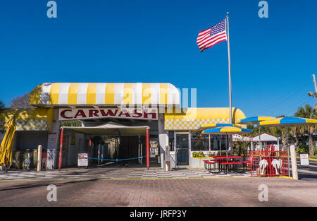 Classic Americana...a traditional 1950's car wash with American flag along a highway in Florida