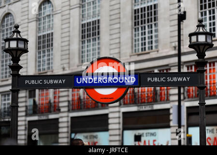 London Underground sign above the entrance to a public subway leading to Piccadilly Circus underground station. - Stock Photo