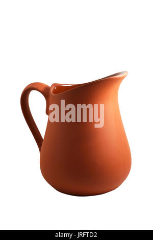 traditional brown ceramic jug on white background - Stock Photo