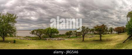Cloudy sky over Rio de la Plata, Colonia del Sacramento, Uruguay. - Stock Photo