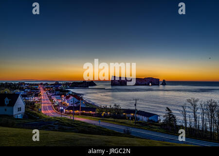 Perce, Canada - June 6, 2017: Famous Rocher Perce rock in Gaspe Peninsula, Quebec, Gaspesie region with cityscape - Stock Photo