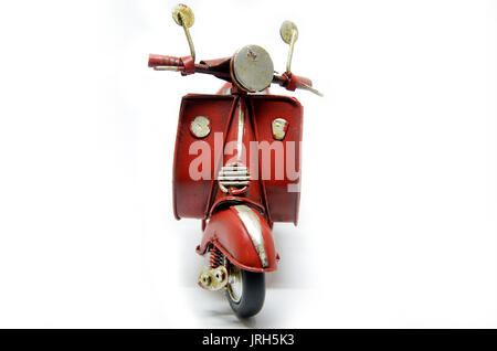 Red old vintage scooter isolated on white - Stock Photo