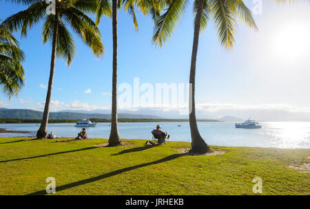People relaxing and watching sunset from Rex Smeal Park, Port Douglas, Far North Queensland, FNQ, QLD, Australia - Stock Photo