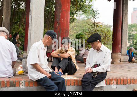 Older people playing street chess - Stock Photo