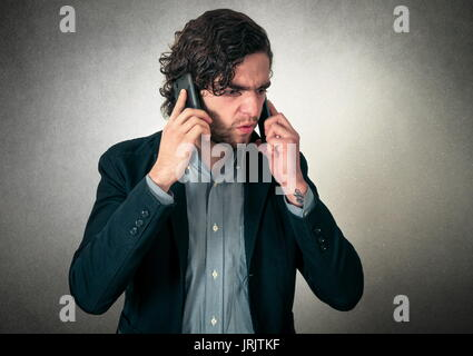 Angry man on the phones - Stock Photo