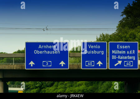 Highway sign, directional sign on the motorway A 3, direction Venlo, Duisburg, Essen, Muelheim an der Ruhr, Oberhausen, - Stock Photo