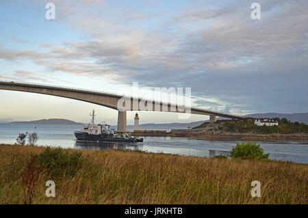 Fishing trawler passing under Isle of Skye road bridge - Stock Photo