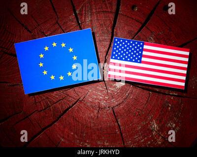 EU flag with USA flag on a tree stump isolated - Stock Photo