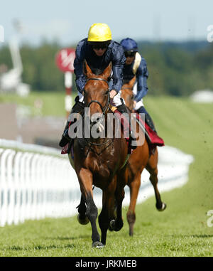 Crystal Ocean ridden by Ryan Moore wins The Qatar Gordon Stakes during day five of the Qatar Goodwood Festival at - Stock Photo