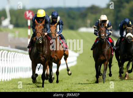 Crystal Ocean (left) ridden by Ryan Moore wins The Qatar Gordon Stakes during day five of the Qatar Goodwood Festival - Stock Photo