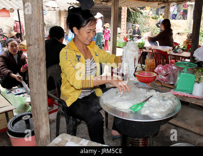 hai duong vietnam april 10 asian woman selling rice cake in the