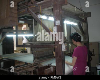 HAI DUONG, VIETNAM, JULY 30: Asian woman spinning and weaving on july, 30, 2014 in Hai Duong, Vietnam. This is special - Stock Photo