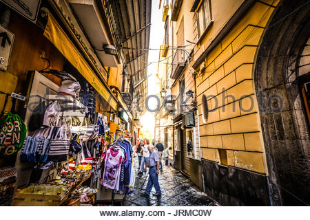 A narrow back alley in Sorrento Italy with an outdoor market selling gifts and souvenirs as tourists and locals - Stock Photo