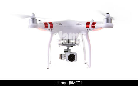 Drone in Flight on a white background - Stock Photo