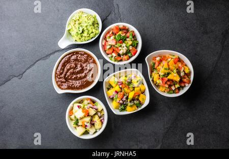 Traditional famous mexican sauces chocolate chili mole poblano, pico de gallo, avocado guacamole, salsa bandera, - Stock Photo