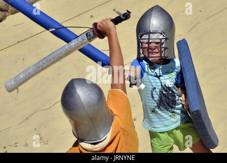 Crimea, Russia. 5th Aug, 2017. Children participate in the 17th Genoese Helmet international knight festival attracting - Stock Photo