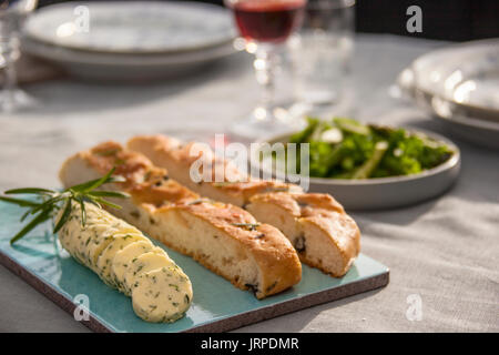 Closeup of Focaccia bread and herbed butter - Stock Photo