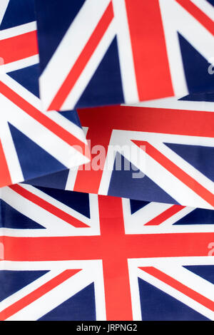 Cluster of mini Union Jack flags. Metaphor British patriotism, being patriotic, celebrating the Brit way of life, - Stock Photo