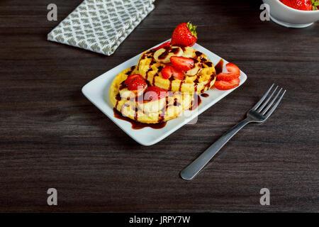 Homemade Belgian waffles with strawberries Waffles bakery, breakfast, crispy, - Stock Photo