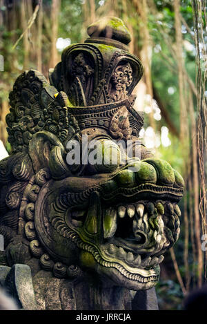 Scary woman sculpture with moss at Sacred Monkey Forest sanctuary in Ubud Bali Indonesia - Stock Photo