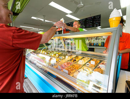Customer buying from the Wicked Ice Cream Shop in Macrossan Street, Port Douglas, Far North Queensland, FNQ, QLD, - Stock Photo