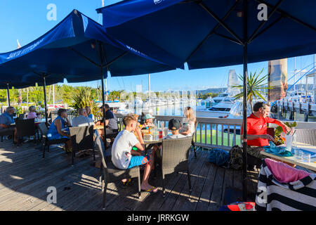 Café and Restaurant terrace overlooking the Reef Marina, Port Douglas, Far North Queensland, FNQ, QLD, Australia - Stock Photo