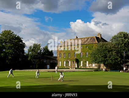 Cricket match in the village of Crakehall, North Yorkshire, England UK - Stock Photo