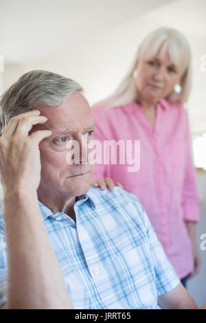 Mature Woman Comforting Man With Depression At Home - Stock Photo